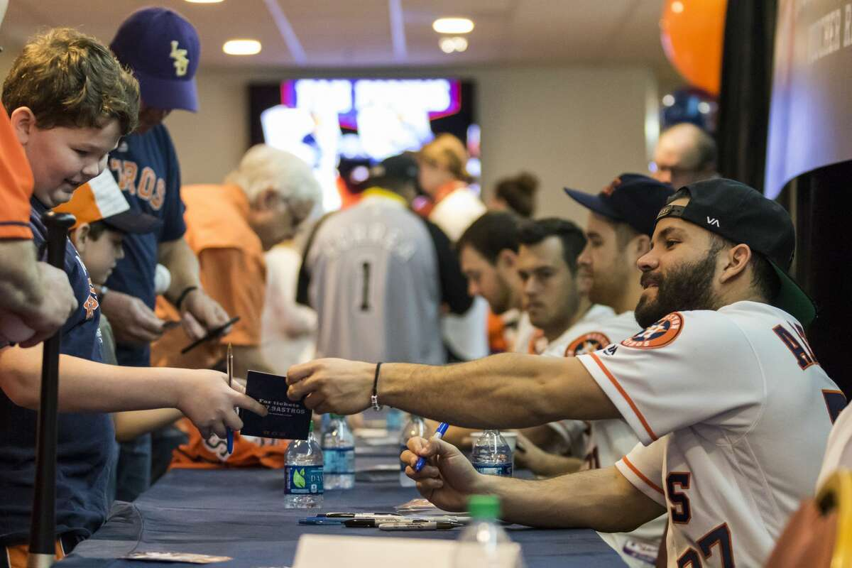 Astros' infielder Jose Altuve signs autographs during Astros Fan Fest at Minute Maid Park on Saturday, Jan. 21, 2017, in Houston. ( Joe Buvid / For the Chronicle )