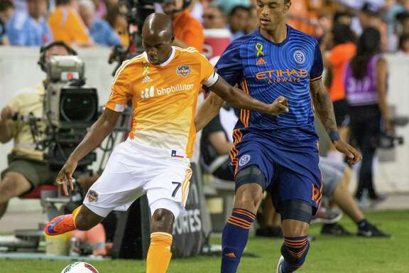 Houston Dynamo midfielder DaMarcus Beasley (7) prepares to kick the ball in front of New York City FC forward Khiry Shelton (19) during the first half of action between the Houston Dynamo and the New York City FC during an MLS soccer game at BBVA Compass, Friday, September 30, 2016, in Houston. (Juan DeLeon/Houston Chronicle )