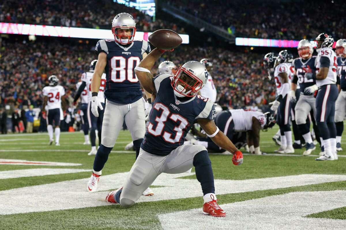 FOXBORO, MA - JANUARY 14: Dion Lewis #33 of the New England Patriots celebrates after scoring a touchdown in the fourth quarter against the Houston Texans during the AFC Divisional Playoff Game at Gillette Stadium on January 14, 2017 in Foxboro, Massachusetts. (Photo by Jim Rogash/Getty Images) ***BESTPIX*** ORG XMIT: 691945243