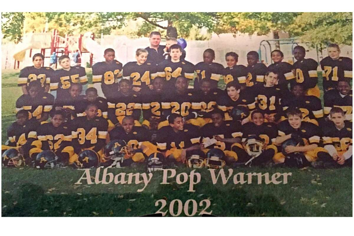 Patriots running back Dion Lewis, middle row and fifth from the left, palyed with the Albany Pop Warner program in 2002. (Photo courtesy Kevin Quinlivan)