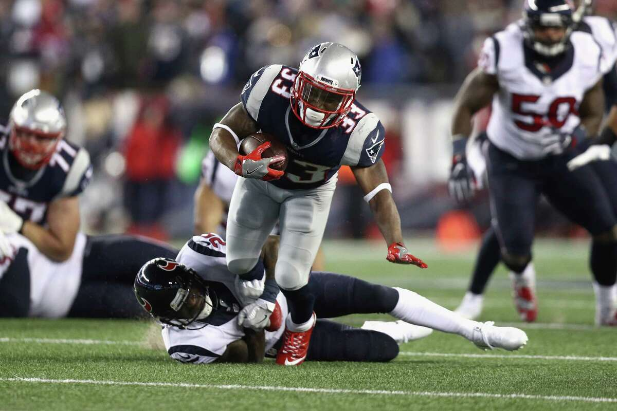 FOXBORO, MA - JANUARY 14: Dion Lewis #33 of the New England Patriots is tackled in the second half against the Houston Texans during the AFC Divisional Playoff Game at Gillette Stadium on January 14, 2017 in Foxboro, Massachusetts. (Photo by Maddie Meyer/Getty Images) ORG XMIT: 691945243