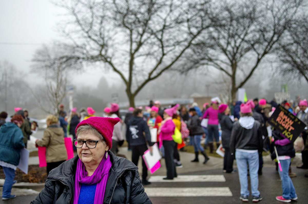"""Amy Rogers prepares to participate in the Midland Sister """"Women's March"""" to protest President Donald Trump on Saturday. Hundreds marched and protested along both sides of of Saginaw Road between Eastlawn Drive and Washington Street during the event which was held to coincide with the """"Women's March on Washington"""" in Washington, D. C."""