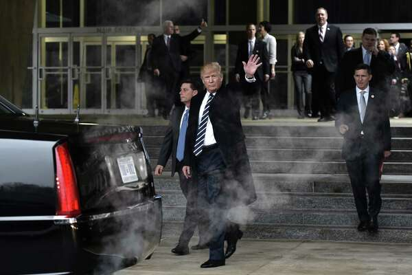 "US President Donald Trump makes his way to his limousine following a visit to the Central Intelligence Agency (CIA) in Langley, Virginia, on January 21, 2017. Trump told the CIA Saturday it had his fervent support as he paid a visit to mend fences after publicly rejecting its assessment that Russia tried to help him win the US election. ""I am with you 1,000 percent,"" Trump said in a short address to CIA staff after his visit to the agency headquarters in Virginia.  / AFP PHOTO / MANDEL NGANMANDEL NGAN/AFP/Getty Images ORG XMIT: US Presid"
