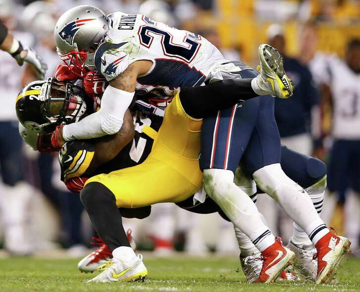 FILE - In this Oct. 23, 2016, file photo, Pittsburgh Steelers running back Le'Veon Bell (26) is tackled by New England Patriots strong safety Patrick Chung (23) during the second half of an NFL football game in Pittsburgh. The Steelers and Patriots meet in the AFC championship game on Sunday, Jan. 22.  (AP Photo/Jared Wickerham, File)