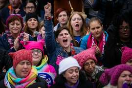 Gina Christo of Philadelphia, PA (center) cheers during the rally at the women's march in Washington, D.C., on Saturday, Jan. 21, 2017.