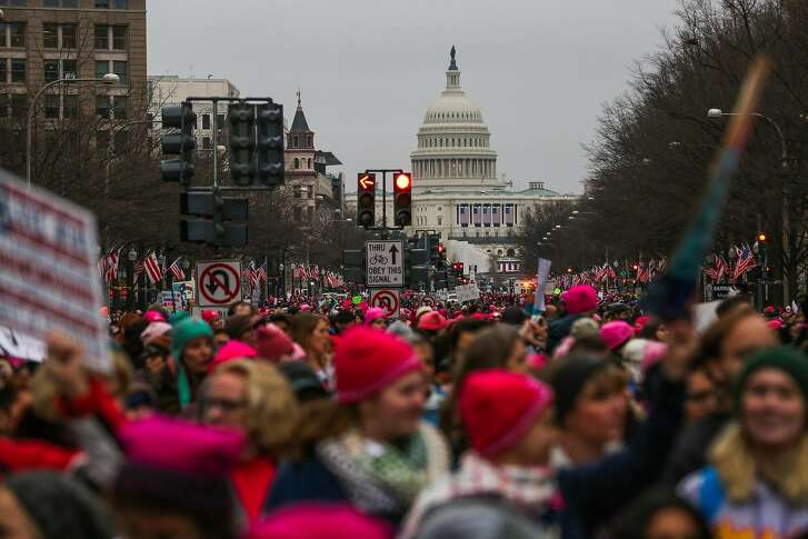 The United States Capitol is seen as thousands of people march down Pennsylvania Avenue during the women's march in Washington, D.C., on Saturday, Jan. 21, 2017.