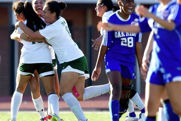 Oak Ridge's Kennedy Jones (28) reacts in frusteration for not getting an offside call as Spring celebrates a goal by Alexandra Cabezas (10) during the second period of a championship match in the Spring ISD Tournament Saturday, Jan. 21, 2017, in Spring. Spring defeated Oak Ridge 2-1.