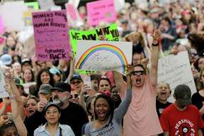 More than 20,000 people in Houston gathered Saturday at City Hall, joining tens of thousands of other Texans in protest. Story on page A3.