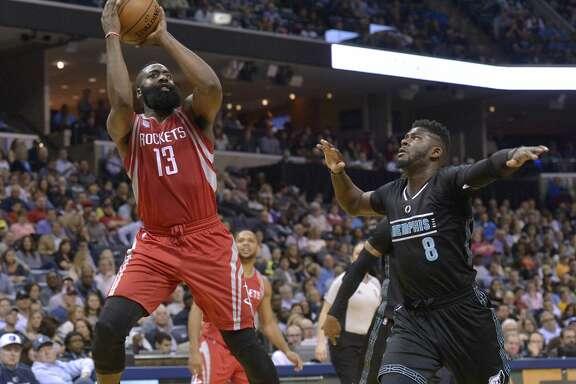 Houston Rockets guard James Harden (13) shoots against Memphis Grizzlies forward James Ennis (8) in the first half of an NBA basketball game Saturday, Jan. 21, 2017, in Memphis, Tenn. (AP Photo/Brandon Dill)