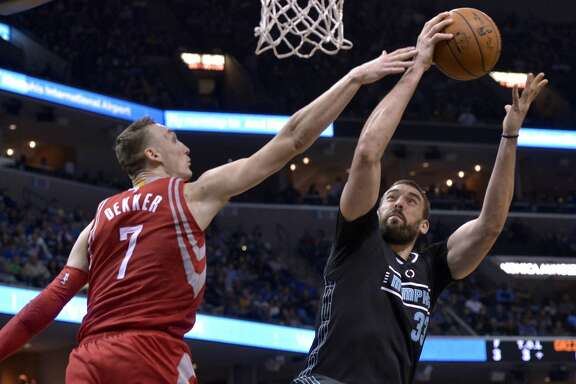 Memphis Grizzlies center Marc Gasol (33) shoots against Houston Rockets forward Sam Dekker (7) in the second half of an NBA basketball game Saturday, Jan. 21, 2017, in Memphis, Tenn. (AP Photo/Brandon Dill)