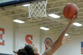 Priscilla Williams (15) of Seven Lakes attempts a reverse lay-up during the second half of a girls basketball game between the Seven Lakes Spartans and the Tompkins Falcons on Tuesday January 17, 2017 at Seven Lakes High School, Katy, TX.