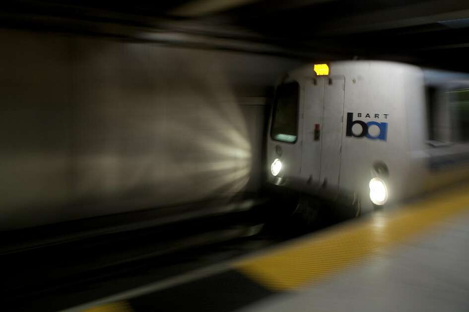 A BART train arrives at at Embarcadero station during early morning rush hours in San Francisco Monday morning, June 29, 2009. BART and its two largest unions have agreed to extend labor contract through July 9 to continue ongoing new contract negotiations and forestall possible strike which would cripple the regions traffic and public transportation system. BART currently carries approximately 355,000 riders on a daily basis.