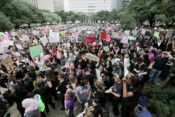 "Marchers gather at Houston City Hall in what one organizer described as ""the biggest crowd ever."""