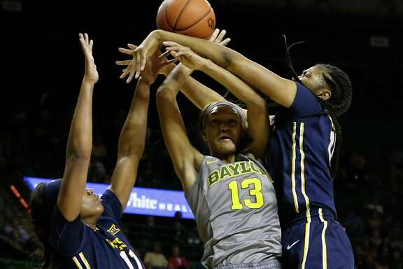 Baylor's Nina Davis, center, gets caught in close quarters with West Virginia defenders Teana Muldrow, left, and Lanay Montgomery in the second half.