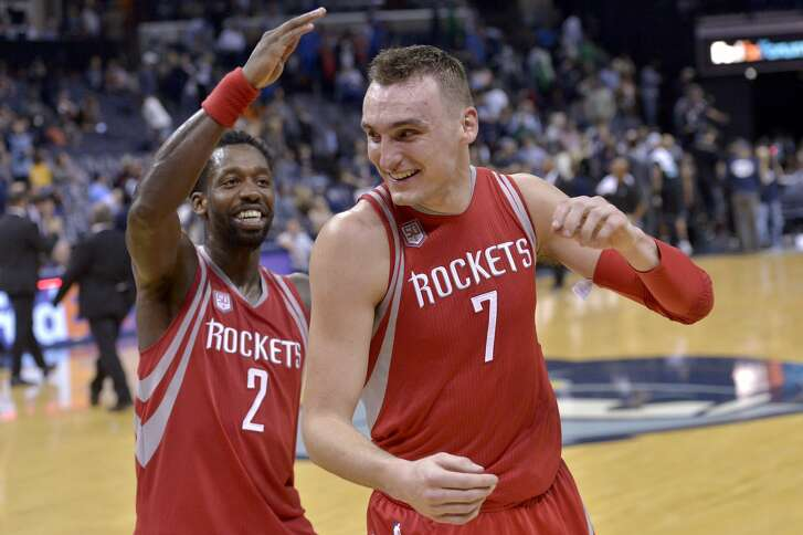 Houston Rockets guard Patrick Beverley (2) congratulates forward Sam Dekker (7) after Dekker scored 30 points in an NBA basketball game against the Memphis Grizzlies Saturday, Jan. 21, 2017, in Memphis, Tenn. The Rockets won by a score of 119-95. (AP Photo/Brandon Dill)