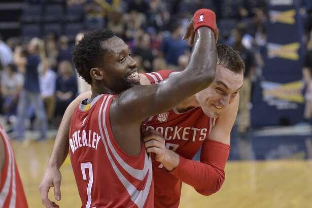 Houston Rockets guard Patrick Beverley, left, congratulates forward Sam Dekker after Dekker scored 30 points in an NBA basketball game against the Memphis Grizzlies Saturday, Jan. 21, 2017, in Memphis, Tenn. The Rockets won by a score of 119-95. (AP Photo/Brandon Dill)