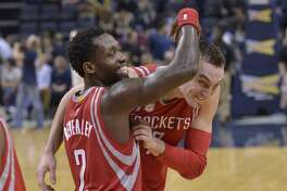 Houston Rockets guard Patrick Beverley, left, congratulates forward Sam Dekker after Dekker scored 30 points in an NBA basketball game against the Memphis Grizzlies Saturday, Jan. 21, 2017, in Memphis, Tenn. The Rockets won by a score of 119-95. (AP Photo/Brandon Dill)