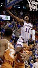 Kansas' Josh Jackson soars over Texas' Jarrett Allen to put up a shot during the first half, helping the Jayhawks jump out to a 41-33 lead at the break.