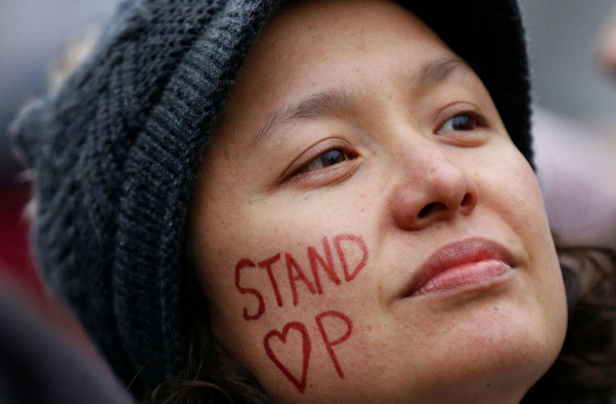 Rhianon Liu of Santa Rosa listens to speakers during a rally in Civic Center Plaza before the Women's March Jan. 21, 2017 in San Francisco, Calif. Thousands gathered in San Francisco to march in solidarity with the Women's March on Washington D.C. to protest the presidency of Donald J. Trump and to rally for the rights of all races, classes and gender identities.