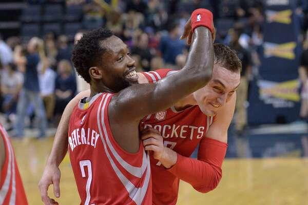 Rockets guard Pat Beverley, left, congratulates forward Sam Dekker after Dekker scored 30 points on 12-for-19 shooting in 35 minutes against the Grizzlies.