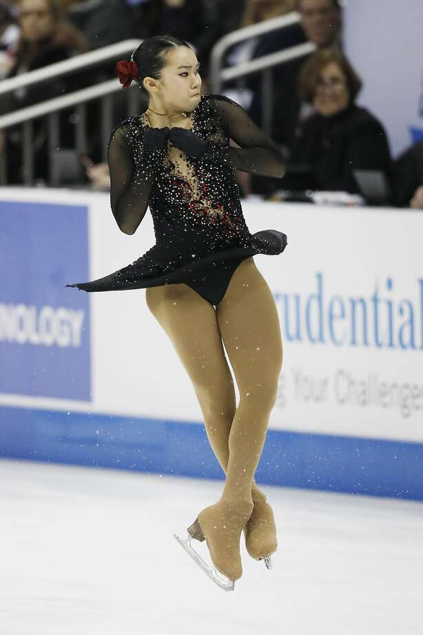 Fremont's Karen Chen, 17, spins with determination during her winning free-skate program in Kansas City, Mo. Photo: Colin E. Braley, Associated Press