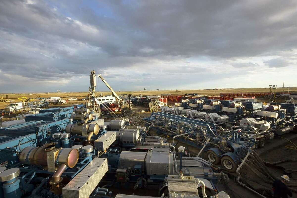 File photo of Baker Hughes crews and equipment work at a hydraulic fracturing site in Pennsylvania's Marcellus Shale. The U.S. Geological Survey estimates that the Mancos Basin in Colorado holds 66 trillion cubic feet of natural gas on federal lands - a deposit close in size to the Marcellus Shale in Pennsylvania. Oilmen are hoping Donald Trump's White House opens more drilling on federal lands.