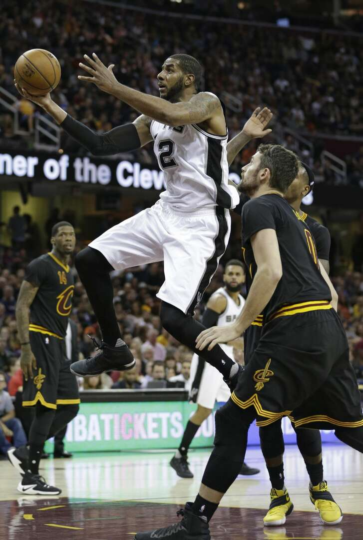 San Antonio Spurs' LaMarcus Aldridge, left, drives to the basket against Cleveland Cavaliers' Kevin Love in the first half of an NBA basketball game, Saturday, Jan. 21, 2017, in Cleveland. (AP Photo/Tony Dejak)