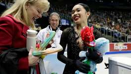 KANSAS CITY, MO - JANUARY 21:  Karen Chen comes off the ice and is greeted by coach Tammy Gambill after her performance in the Championship Ladies Free Skate during the 2017 U.S. Figure Skating Championships at the Sprint Center on January 21, 2017 in Kansas City, Missouri.  Chen placed first and won the gold medal and became the 2017 US Ladies Champion.  (Photo by Jamie Squire/Getty Images)