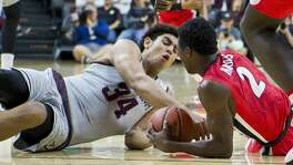 Texas A&M sophomore center Tyler Davis (34) wrestles for the ball with Georgia freshman guard Jordan Harris (2) during a game played Saturday, Jan. 21, 2017, at Reed Arena in College Station, Texas.