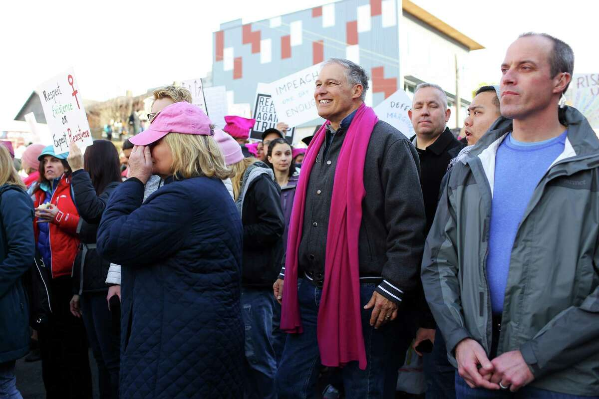 Governor Jay Inslee and his wife Trudee participate in the Women's March on Seattle. Well over 100,00 people took to the streets, bringing hats and signs, for the march, Saturday, Jan. 21, 2017.