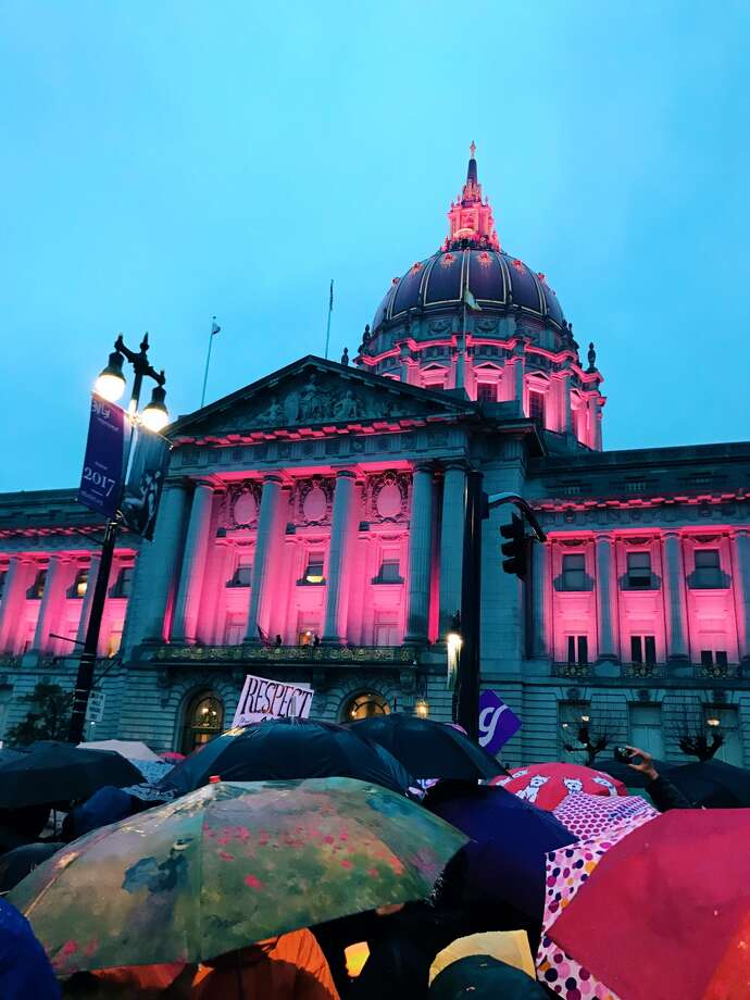 City Hall lit up pink before dusk Saturday during the San Francisco gathering of the Women's March. Explore this gallery for more photos from the Women's March in San Francisco. Photo: Sonali Perera