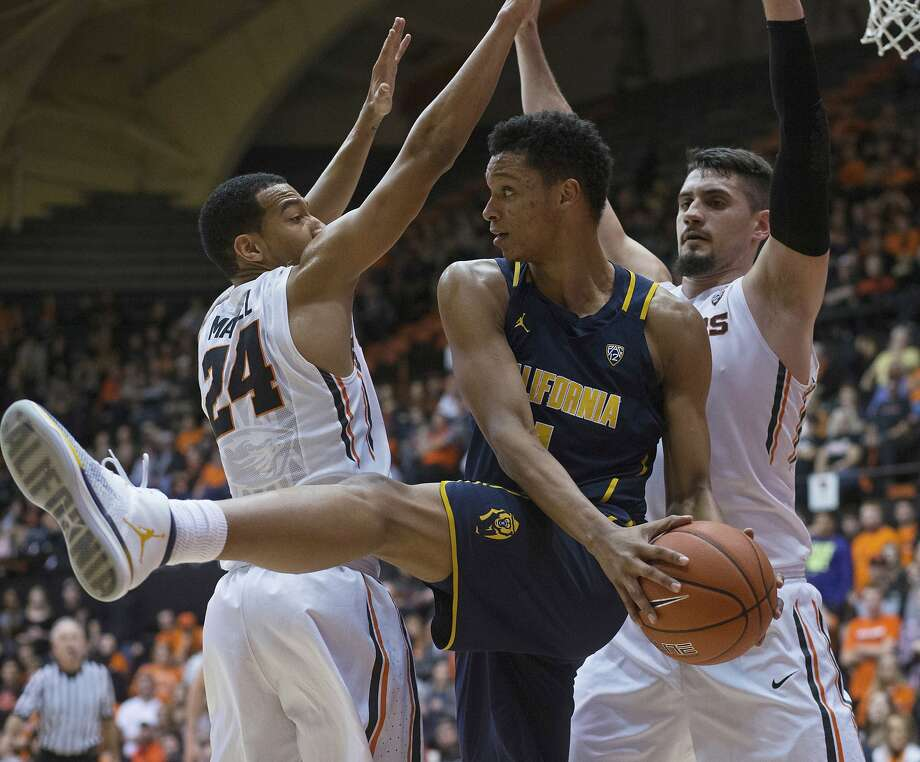 California's Ivan Rabb, center, is doubled-teamed by Oregon State's Kendal Manuel, left, and Gligorije Rakocevic, right, during the first half of an NCAA college basketball game in Corvallis, Ore., Saturday, Jan. 21, 2017. (AP Photo/Timothy J. Gonzalez) Photo: Timothy J. Gonzalez, Associated Press