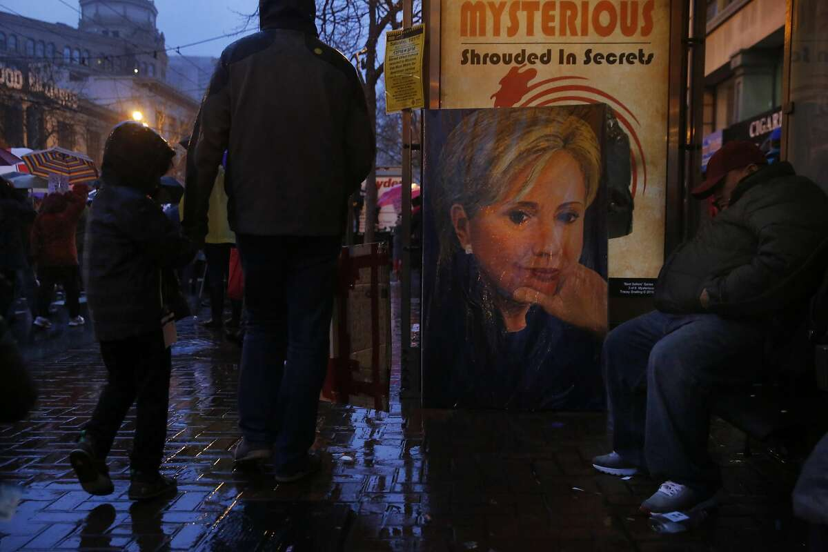 A portrait of Hillary Clinton sits at a bus stop as protesters stream past on Market street during the Women's March Jan. 21, 2017 in San Francisco, Calif. Thousands gathered in San Francisco to march in solidarity with the Women's March on Washington D.C. to protest the presidency of Donald J. Trump and to rally for the rights of all races, classes and gender identities.