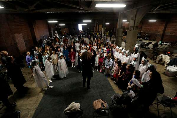 """SF Girls Chorus warms up off set for their their performance in a television opera called """"Vireo."""" at the 16th Street Station on Saturday, Jan. 21, 2017 in Oakland, Calif. It's the last episode of a 12-episode season.  The whole season will air in early"""