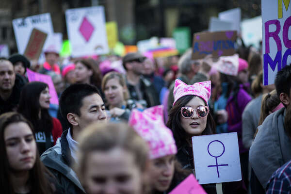 Over 100,000 demonstrators walk up 4th Ave towards the Seattle Center in the WomenÕs March on Seattle on Saturday, Jan. 21, 2017.