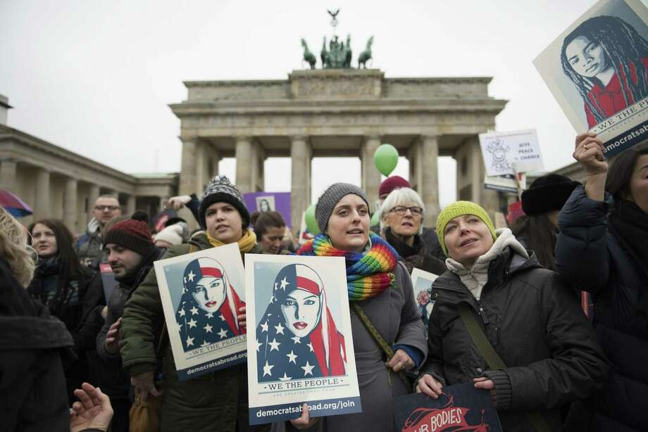 BERLIN, GERMANY - JANUARY 21: Women and men attend a protest for women's rights and freedom in solidarity with the Women's March on Washington in front of Brandenburger Tor on January 21, 2017 in Berlin, Germany. The Women's  March originated in Washington DC but soon spread to be a global march calling on all concerned citizens to stand up for equality, diversity and inclusion and for Women's  rights to be recognised around the world as human rights. Global marches are now being held, on the same day, across seven continents. (Photo by Steffi Loos/Getty Images) Photo: Steffi Loos / Getty Images / 2017 Getty Images