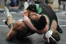 Maloney's Markeese Thompson, left, and New Milford's Cameron Berger wrestle in a 160-pound semifinal match Saturday at the New Milford tournament.