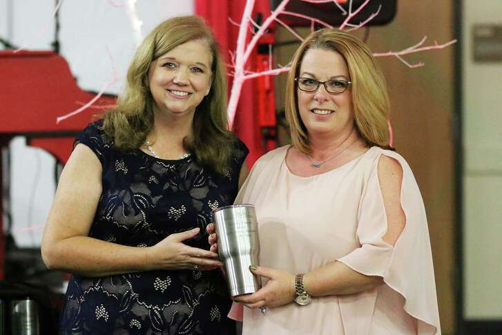 Sterling Funeral Home was named the Service Business of the Year. Kimberley Mulkey is joined by Chamber Executive Director Paula Moorhaj.
