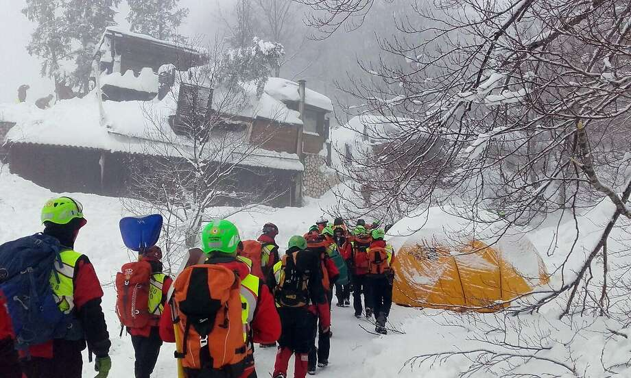 "In this undated photo released Sunday, Jan. 22, 2017, rescuers work in the area of the avalanche-hit Rigopiano hotel, central Italy.  After two days huddled in freezing cold, tons of snow surrounding them in the wreckage of the avalanche-demolished hotel, survivors greeted their rescuers Friday as ""angels."" Among the 10 people pulled out alive was a plucky 6-year-old who just wanted her favorite cookies. (Corpo Nazionale Soccorso Alpino e Speleologico/The National Alpine Cliff and Cave Rescue Corps (CNSAS) via AP) Photo: Associated Press"