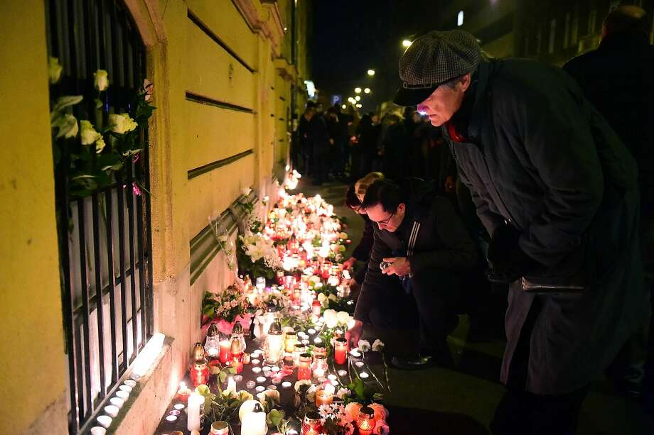 Mourners place candles and flowers at Szinyei Merse Pal high school in Budapest, Hungary. Photo: ATTILA KISBENEDEK, AFP/Getty Images