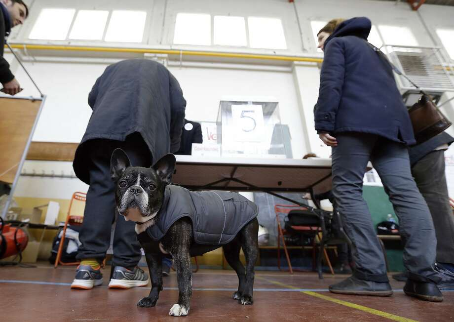 Voters in Marseille prepare to cast their ballots in the Socialist primary election. Manuel Valls, a former prime minister, will face Benoît Hamon in a runoff vote next week. Photo: Claude Paris, Associated Press
