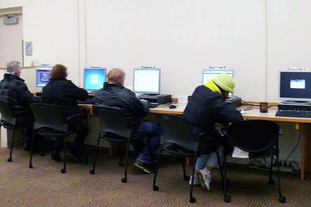 Shortly after the Fairfield Public Library's main branch opens at 1 p.m. on Saturday, computer terminals are in full use.