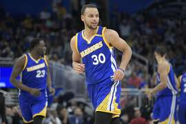 Golden State Warriors guard Stephen Curry (30) looks to a fan in the stands after making a three-point basket during the second half of an NBA basketball game against the Orlando Magic in Orlando, Fla., Sunday, Jan. 22, 2017. (AP Photo/Phelan M. Ebenhack)