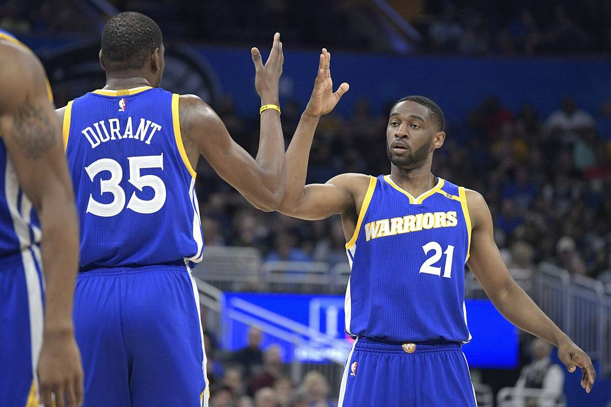 Golden State Warriors forward Kevin Durant (35) is congratulated by guard Ian Clark (21) after making a basket during the first half of an NBA basketball game against the Orlando Magic in Orlando, Fla., Sunday, Jan. 22, 2017. (AP Photo/Phelan M. Ebenhack)