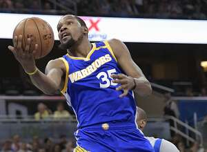 Golden State Warriors forward Kevin Durant (35) goes up to shoot in front of Orlando Magic forward Serge Ibaka during the first half of an NBA basketball game in Orlando, Fla., Sunday, Jan. 22, 2017. (AP Photo/Phelan M. Ebenhack)