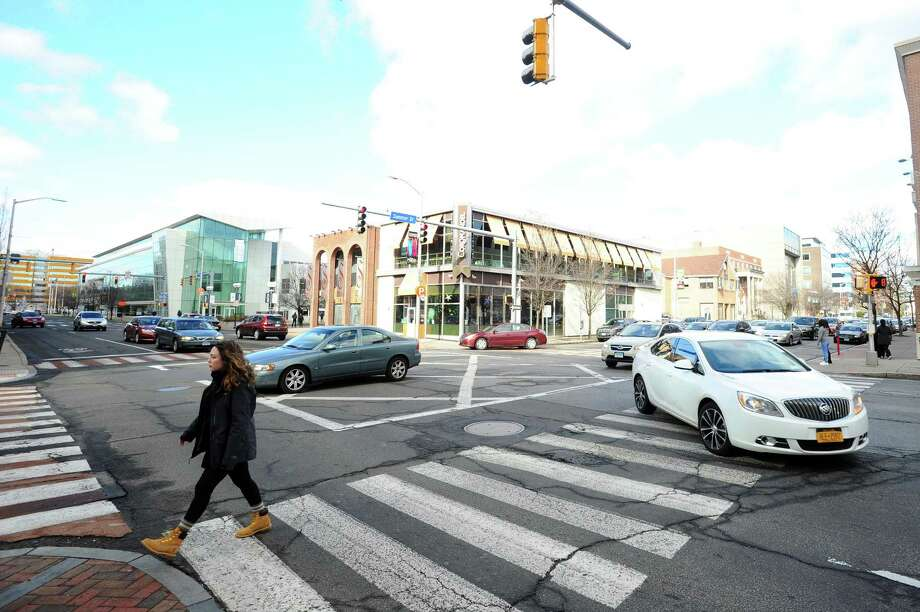 A pedestrian crosses the street at the corner of Summer St. and Broad St. in Stamford. The city is going to spend $863,188 next year to upgrade Summer's intersections with Hoyt, North, Broad and Main to add yield to pedestrians' in crosswalk signs, illuminated no turn on red signs, sidewalk extensions, and more visible crosswalks among other measures. Photo: Michael Cummo / Hearst Connecticut Media / Stamford Advocate