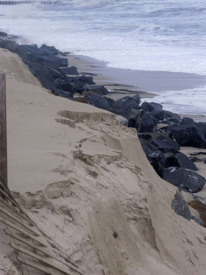 This Oct. 5, 2015, photo shows a privately installed rock wall in Bay Head N.J. exposed to the ocean waves after a storm. Oceanfront homeowners want a judge to exempt them from a plan by Republican Gov. Chris Christie to erect protective sand dunes along New Jerseys entire 127-mile coastline. arguing that their privately funded rock wall provides better protection at no cost to taxpayers. Photo: Wayne Parry, Associated Press