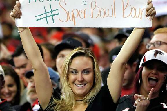 ATLANTA, GA - JANUARY 22: A Atlanta Falcons fan holds up a sign during the game against the Green Bay Packers in the NFC Championship Game at the Georgia Dome on January 22, 2017 in Atlanta, Georgia.