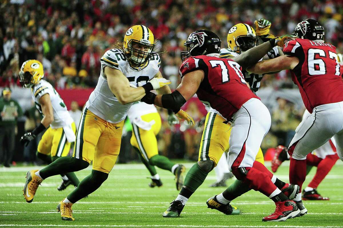 Clay Matthews #52 of the Green Bay Packers is blocked by Jake Matthews #70 of the Atlanta Falcons during the first quarter in the NFC Championship Game at the Georgia Dome on January 22, 2017 in Atlanta, Georgia.