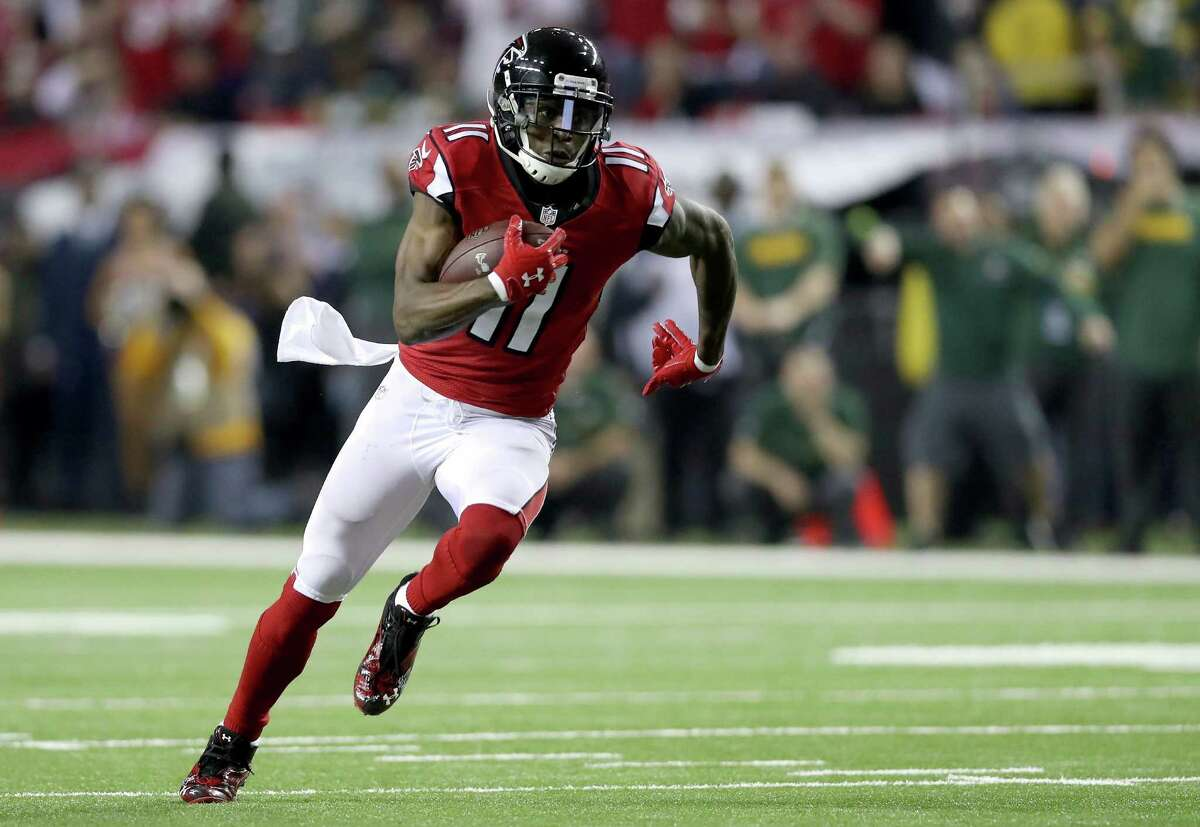 ATLANTA, GA - JANUARY 22: Julio Jones #11 of the Atlanta Falcons runs after a catch in the second quarter against the Green Bay Packers in the NFC Championship Game at the Georgia Dome on January 22, 2017 in Atlanta, Georgia.